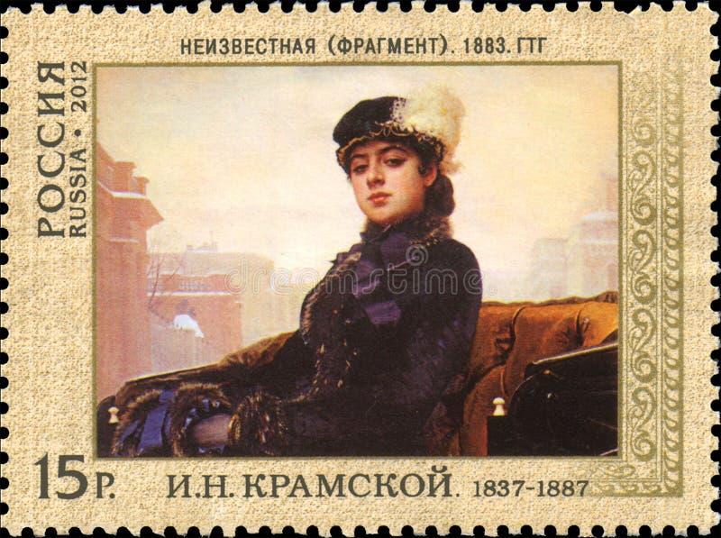 LA RUSSIA - CIRCA 2012: Bollo stampato in Russia, ritratto di una donna sconosciuta, 1883 di manifestazioni immagini stock libere da diritti