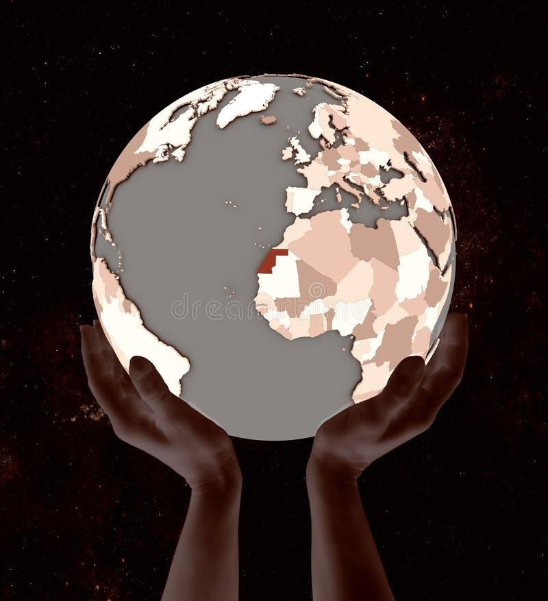La Sahara occidental sur le globe dans des mains illustration stock