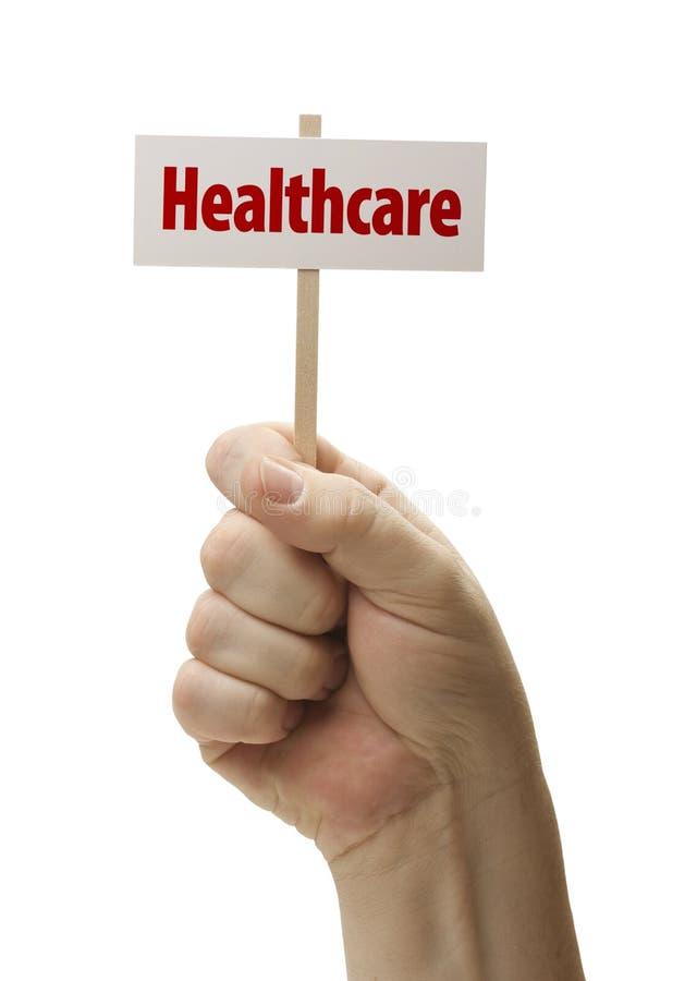 La sanità firma dentro il pugno su bianco immagini stock