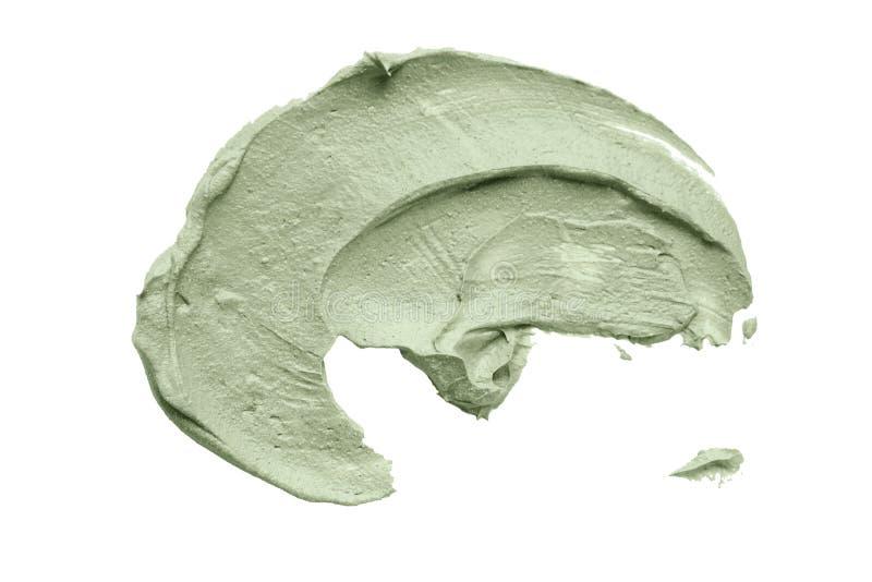 La sbavatura facciale della maschera dell'argilla blu su bianco ha isolato il fondo immagini stock libere da diritti