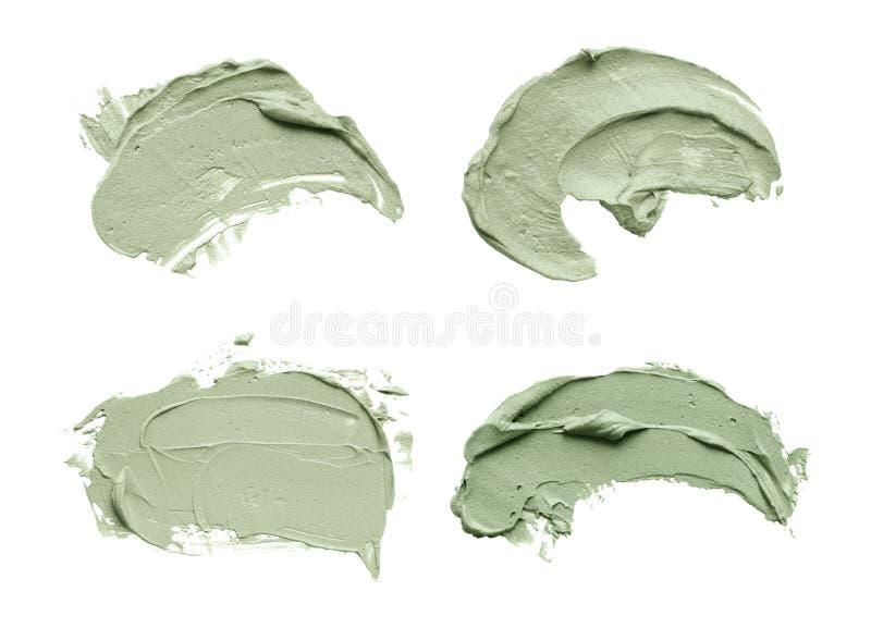 La sbavatura facciale della maschera dell'argilla blu su bianco ha isolato il fondo fotografia stock libera da diritti