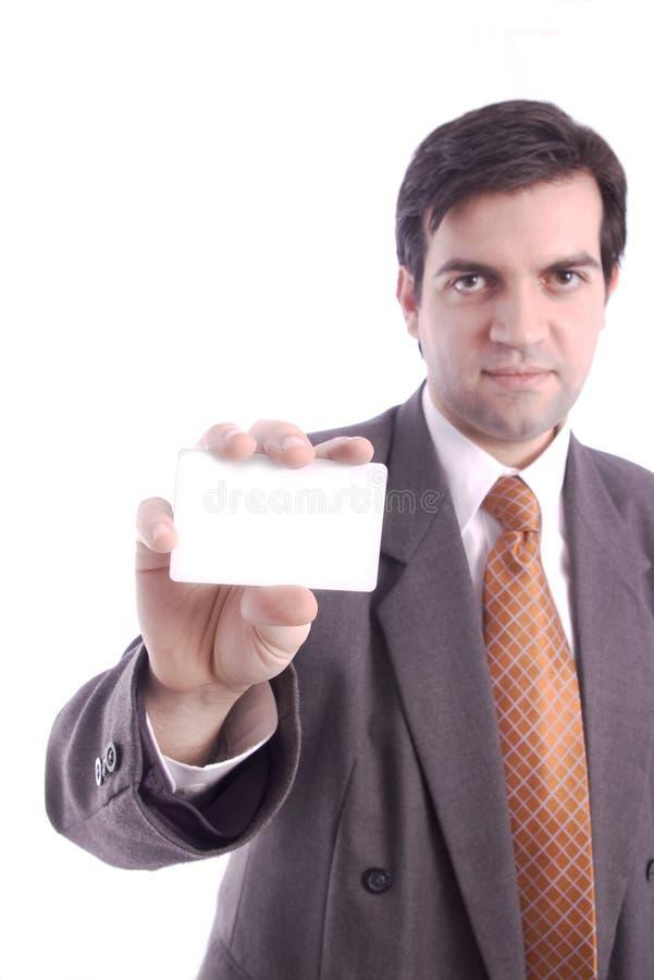 La scheda in bianco ha tenuto da un uomo d'affari fotografia stock libera da diritti