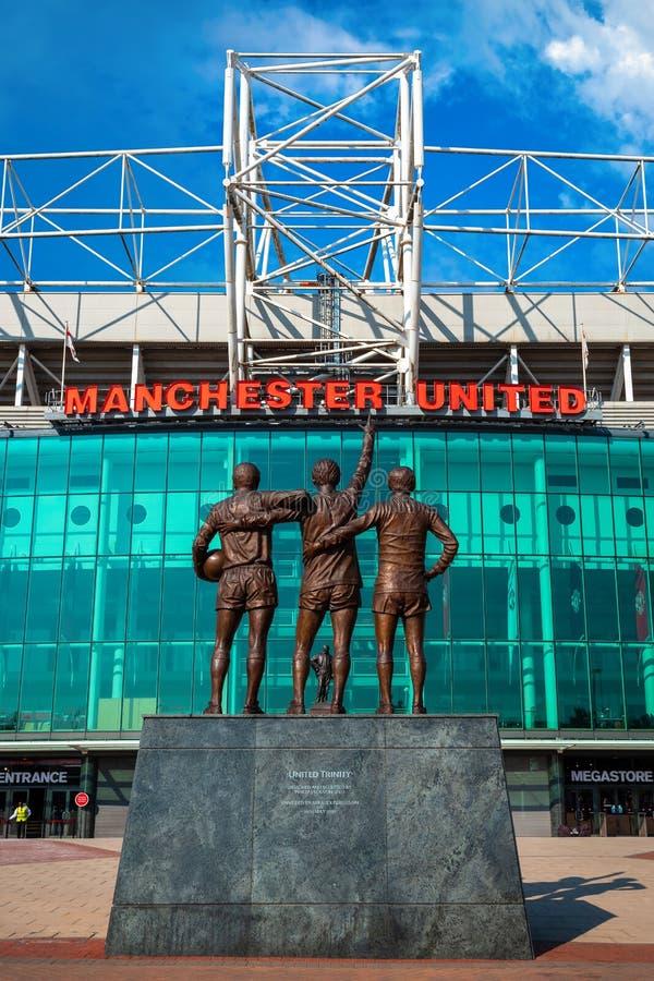 La scultura bronzea unita della trinità al vecchio stadio di Trafford a Manchester, Regno Unito fotografia stock