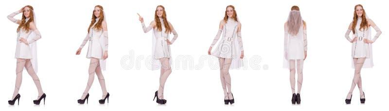 La señora bonita en el vestido encantador ligero aislado en blanco foto de archivo libre de regalías