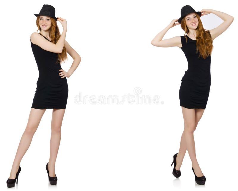 La señora joven en vestido negro con el sombrero negro foto de archivo libre de regalías