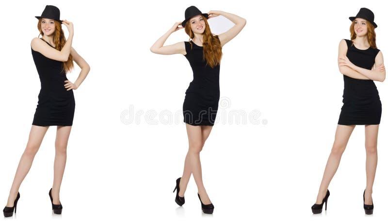 La se?ora joven en vestido negro con el sombrero negro imágenes de archivo libres de regalías