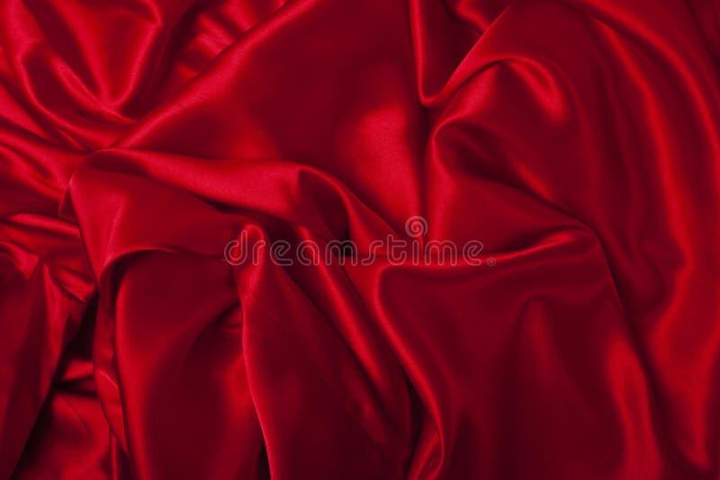 La seda roja elegante lisa puede utilizar como fondo fotos de archivo