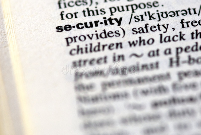 La seguridad de la palabra en un diccionario imágenes de archivo libres de regalías