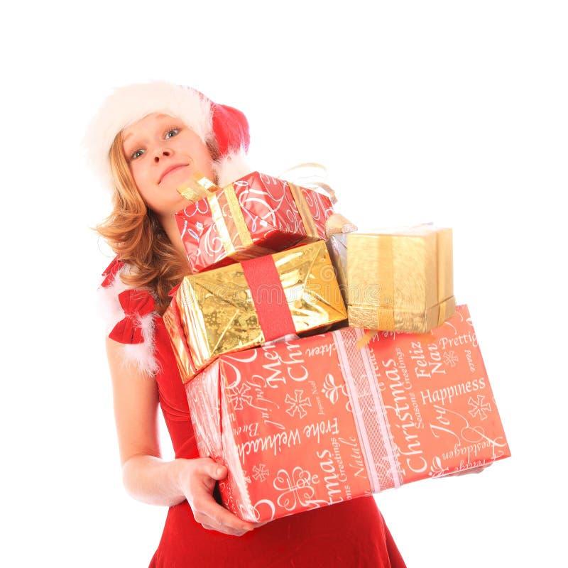 La sig.na Santa sta trasportando troppi presente fotografia stock libera da diritti