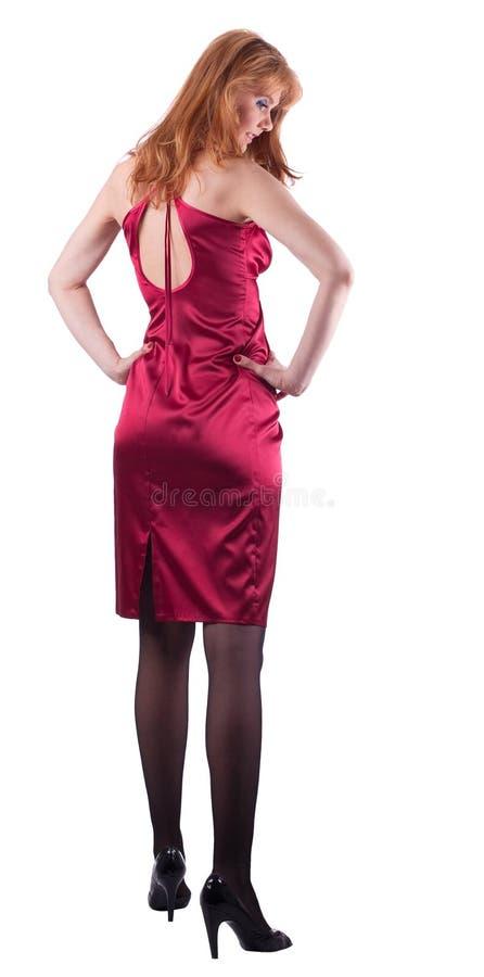 La signora matura alta in vestito rosso da modo ha isolato fotografia stock libera da diritti