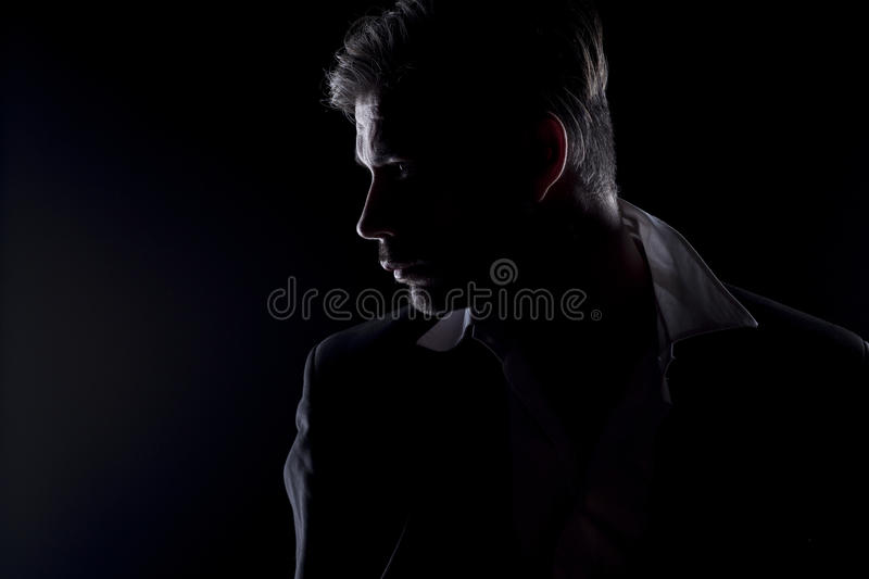 La silhouette de l'homme photo stock