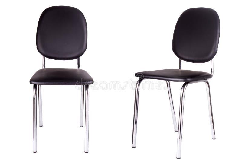 La silla negra de la oficina Aislado en blanco imagenes de archivo