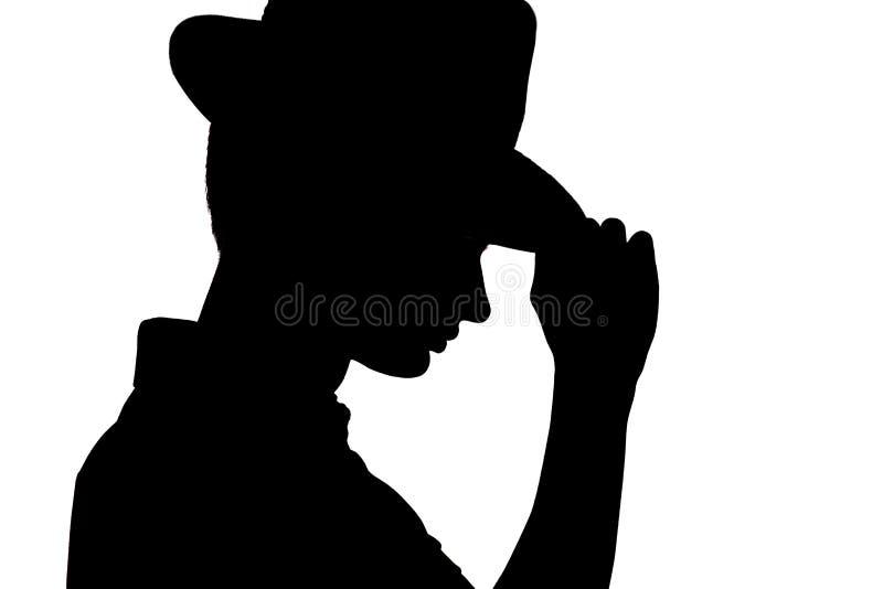 La silueta del hombre joven elegante en el sombrero del negocio, perfil de la cara irreconocible del ` s del hombre en blanco ais fotos de archivo