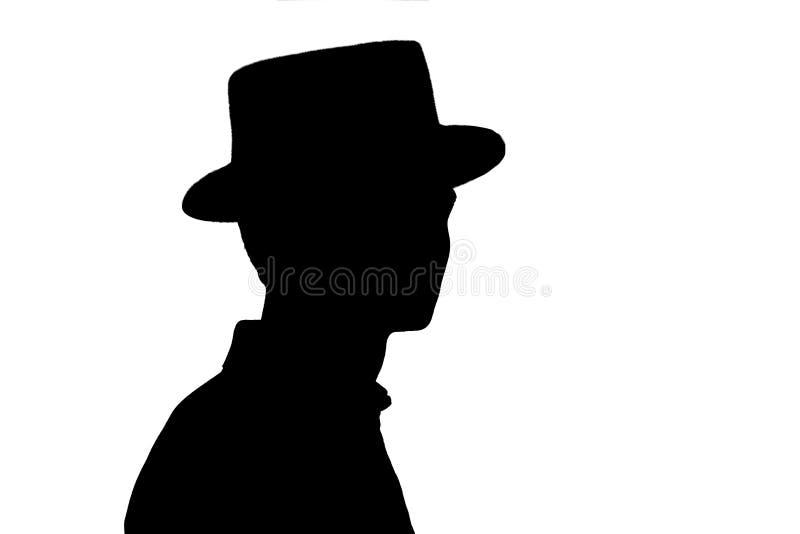 La silueta del hombre joven elegante en el sombrero del negocio, perfil de la persona anónima en blanco aisló el fondo imágenes de archivo libres de regalías