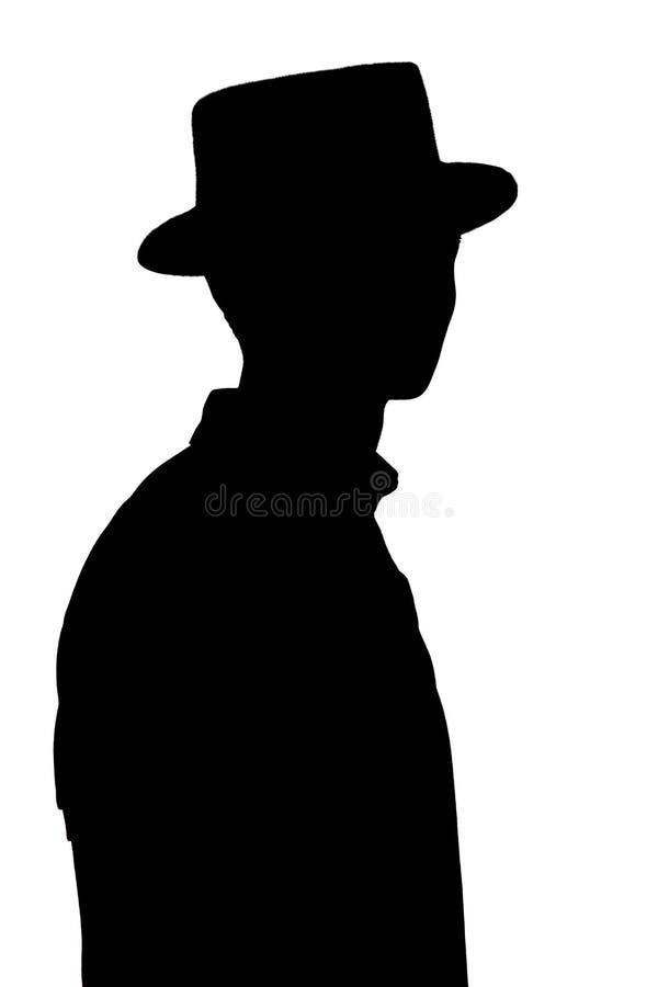 La silueta del hombre joven elegante en el sombrero del negocio, perfil de la persona irreconocible en blanco aisló el fondo fotografía de archivo