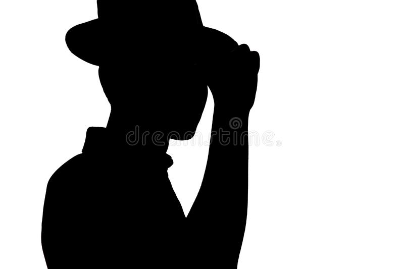 La silueta del hombre joven elegante en el sombrero del negocio, perfil de la persona irreconocible en blanco aisló el fondo imagen de archivo