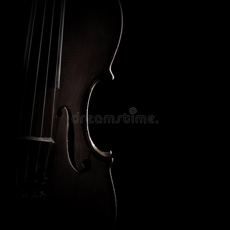 La siluetta del violino mette insieme il primo piano fotografia stock
