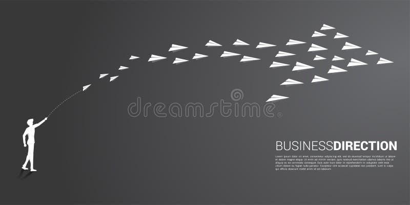 La siluetta dell'uomo d'affari gettare fuori l'aeroplano di carta bianco di origami è sistemata in una forma di grande freccia royalty illustrazione gratis