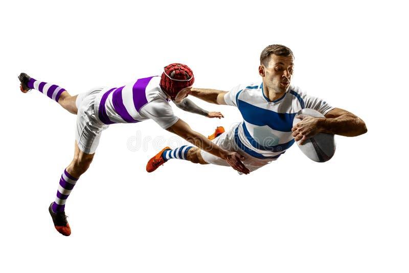 La siluetta di due giocatori maschii di rugby caucasico isolati su fondo bianco fotografie stock libere da diritti
