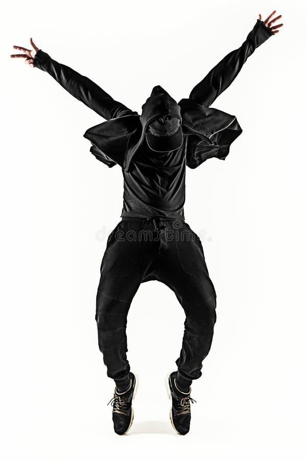 La siluetta di un dancing maschio hip-hop del ballerino della rottura sul fondo bianco fotografia stock libera da diritti