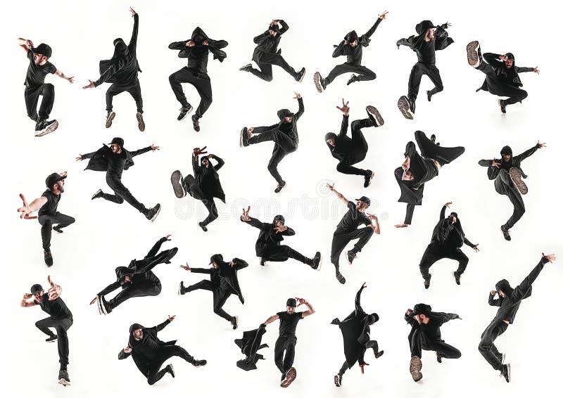La siluetta di un dancing maschio hip-hop del ballerino della rottura sul fondo bianco fotografia stock