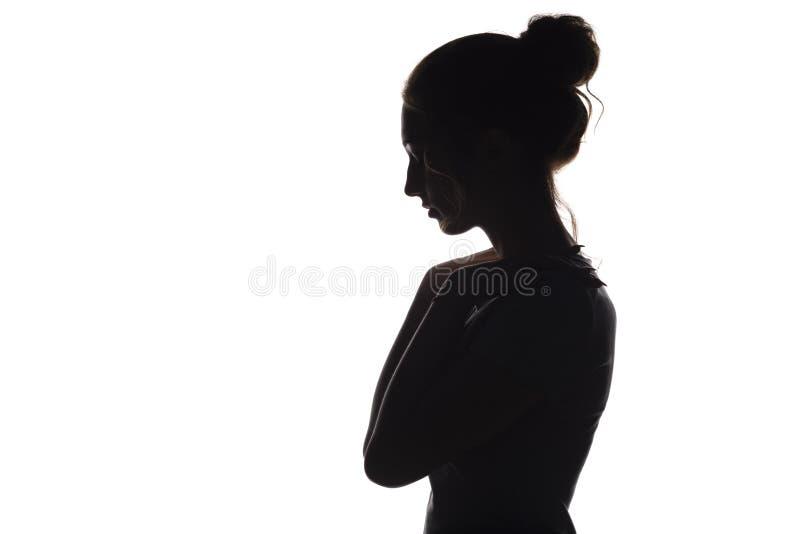 La siluetta di una giovane donna su un bianco ha isolato il fondo, profilo del fronte di bella ragazza immagini stock libere da diritti