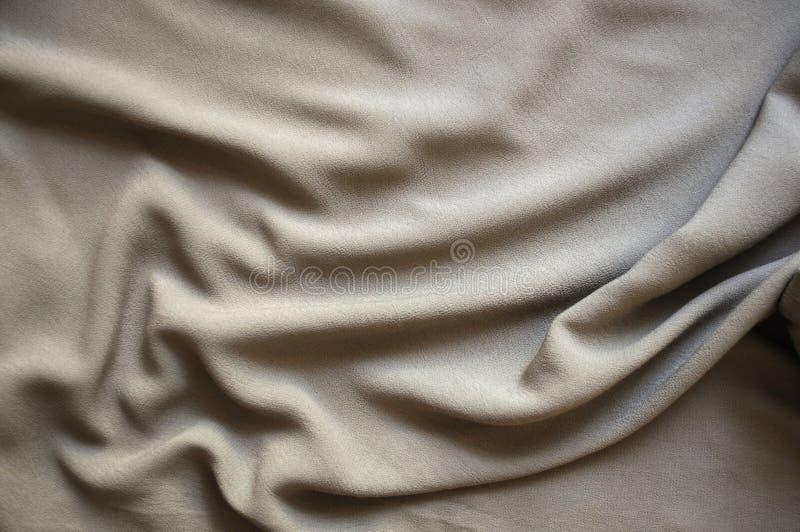 La soie grise drapent images stock