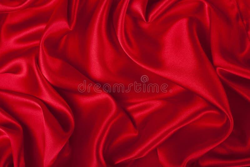 La soie rouge élégante lisse peut utiliser comme fond photo libre de droits
