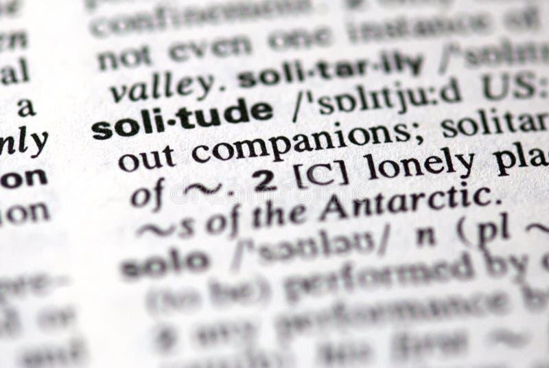 La solitudine di parola in un dizionario fotografia stock libera da diritti