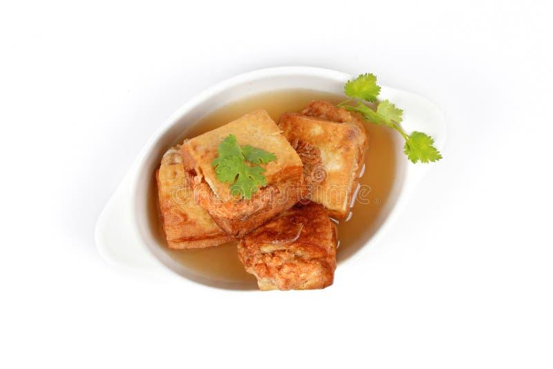 La sopa de la barra de oro como abrigo frito del queso de soja picó el cerdo en sopa Visión superior fotografía de archivo libre de regalías
