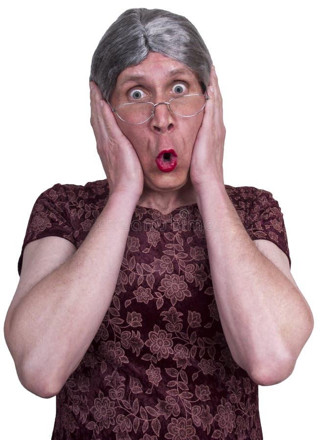 La sorpresa brutta di scossa della signora anziana nonna impaurita ha spaventato immagini stock
