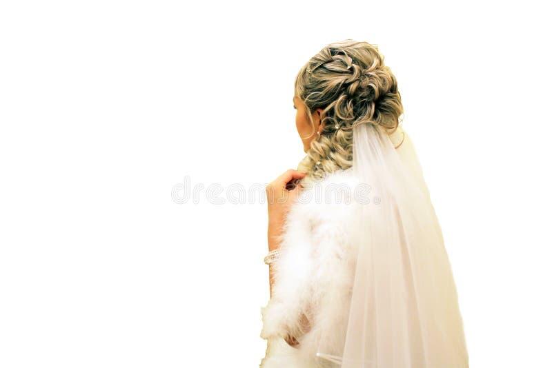 La sposa da dietro, isolato su fondo bianco immagini stock