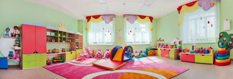 La stanza dei giochi dei bambini di panorama fotografia stock libera da diritti