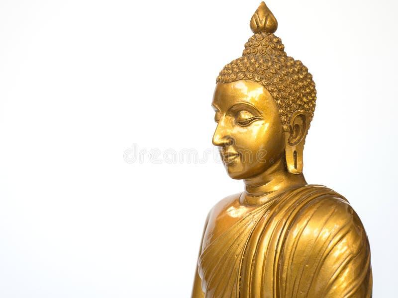 La statua antica dorata di Buddha sui precedenti bianchi ha isolato il fondo Il fronte del Buddha si è girato verso la destra fotografia stock