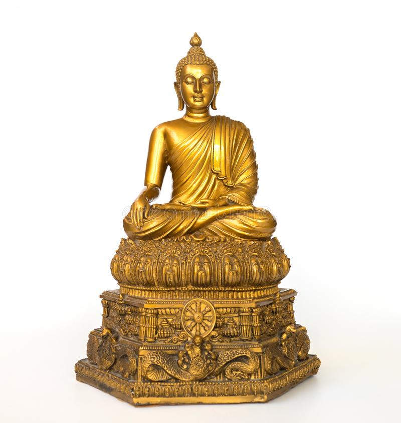 La statue antique d'or de Bouddha sur le fond blanc a isolé le fond Le visage du Bouddha s'est tourné vers le droit images libres de droits