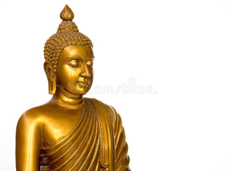 La statue antique d'or de Bouddha sur le fond blanc a isolé le fond Le visage du Bouddha s'est tourné vers la droite photos libres de droits