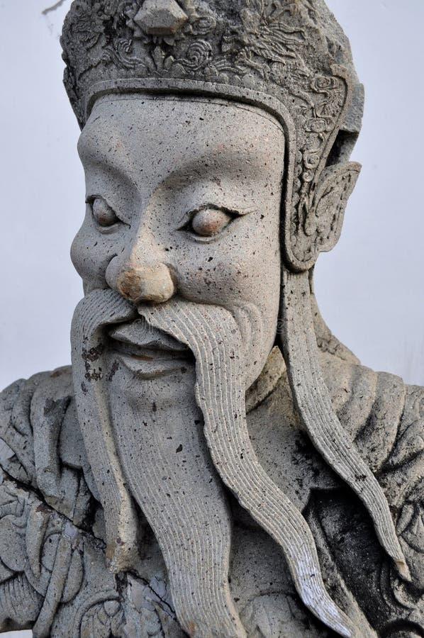 La statue chinoise de guerrier garde Wat Pho à Bangkok photo stock