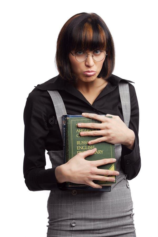 La stretta stupida della scolara del brunette prenota nelle mani fotografie stock