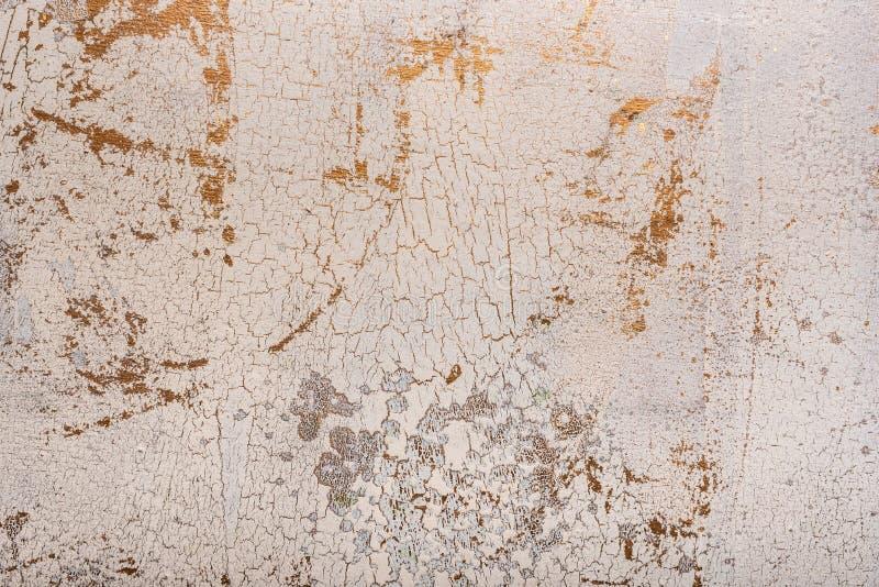 La struttura antica dell'oro e bianca del fondo si è fenduta immagini stock