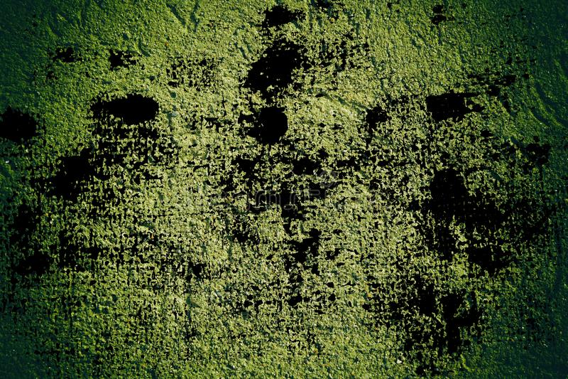 La struttura concreta del gesso di lerciume, superficie della pietra, oscilla il fondo incrinato per la cartolina immagine stock