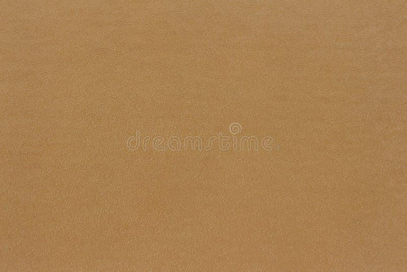 La struttura del fondo è fatta dal beige della copertina di libro immagini stock libere da diritti