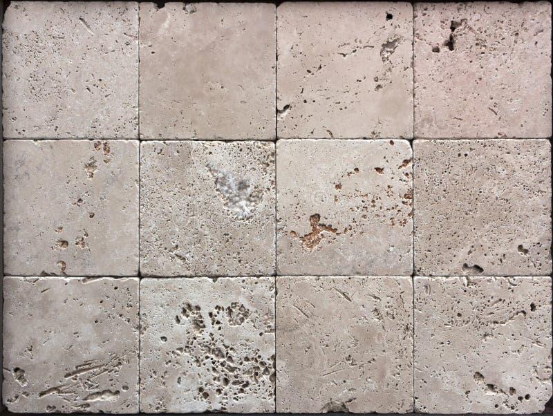 La struttura della parete di pietra, travertino piastrella l'affronto fotografia stock libera da diritti