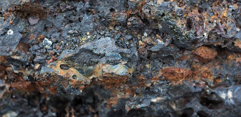 La struttura delle pietre scure di origin_ vulcanico fotografia stock libera da diritti