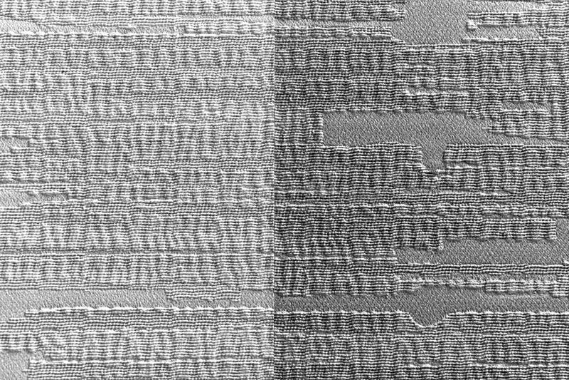 La struttura di carta della carta da parati è leggera e grigio scuro sulla superficie della parete fotografie stock libere da diritti