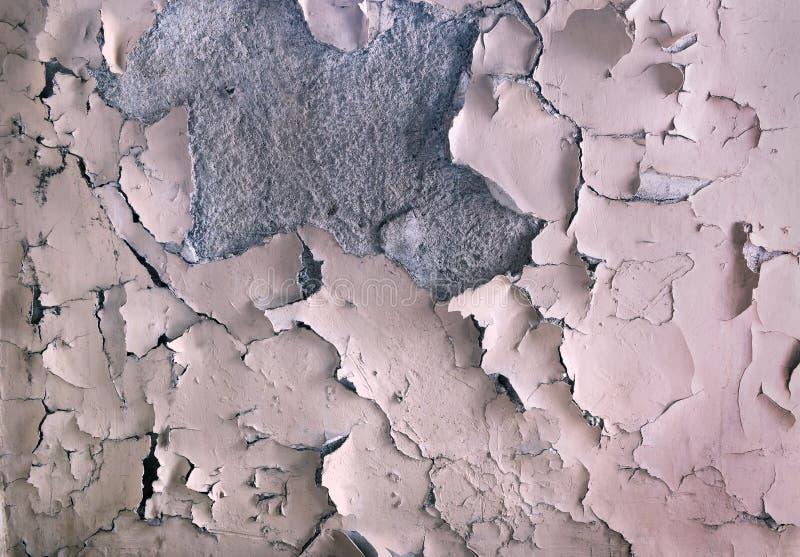 La struttura di vecchia pittura che si sbuccia sulla parete di pietra Fondo della tintura di sfaldamento fotografia stock libera da diritti
