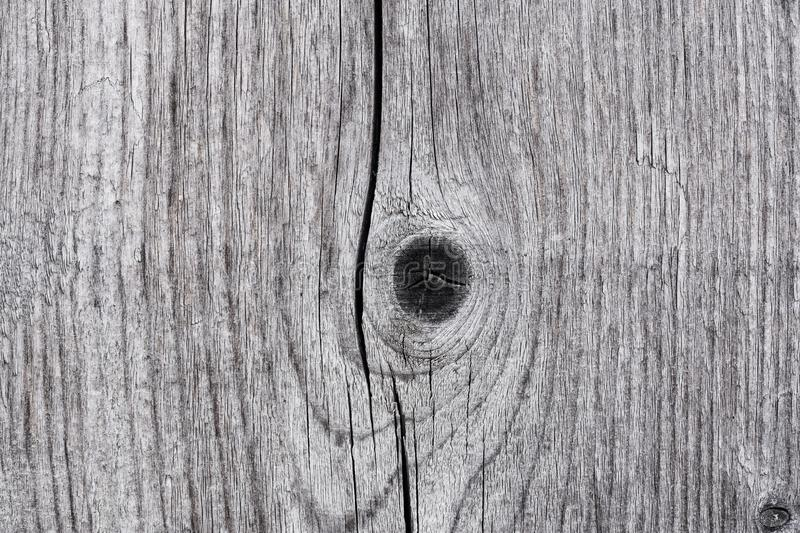 La struttura di vecchia plancia di legno con i nodi si chiude su fotografie stock