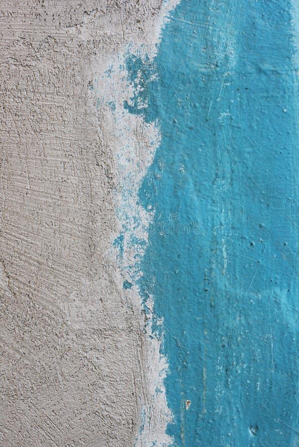 La struttura grezza del gesso ha dipinto la riva di mare di somiglianza blu come fondo fotografie stock