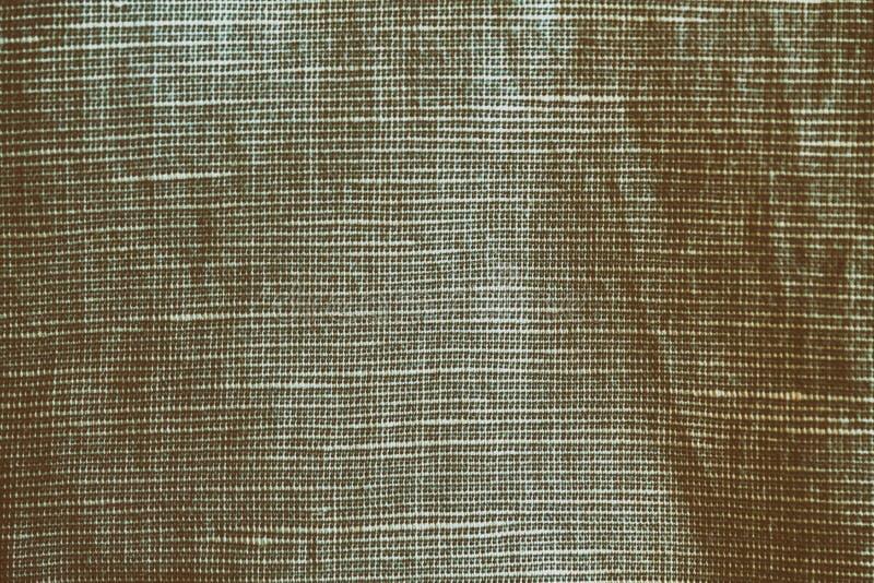 La struttura o il fondo di tela grigia neutrale del primo piano, linea differente ha separato il tessuto fotografie stock