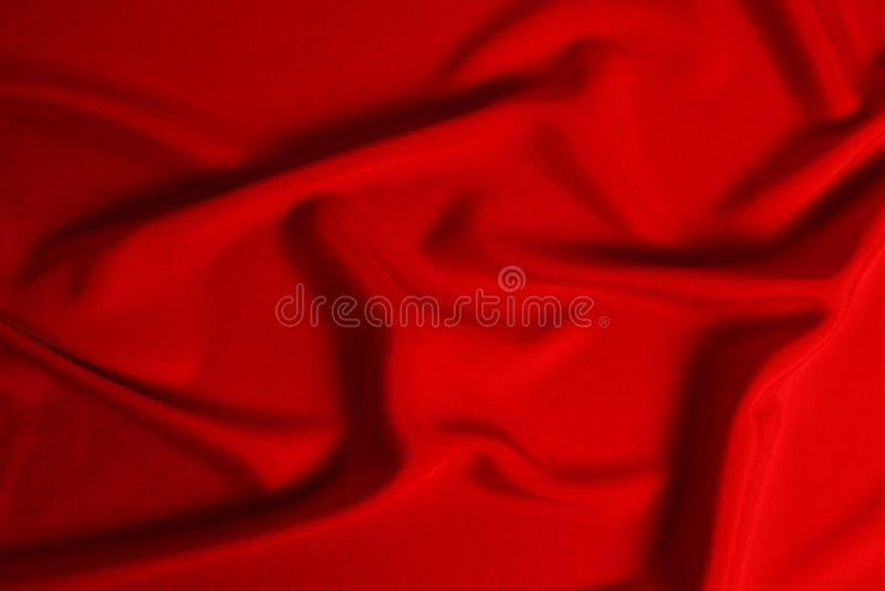 La struttura rossa del tessuto del lusso del raso o della seta pu? usare come fondo astratto Vista superiore fotografia stock libera da diritti