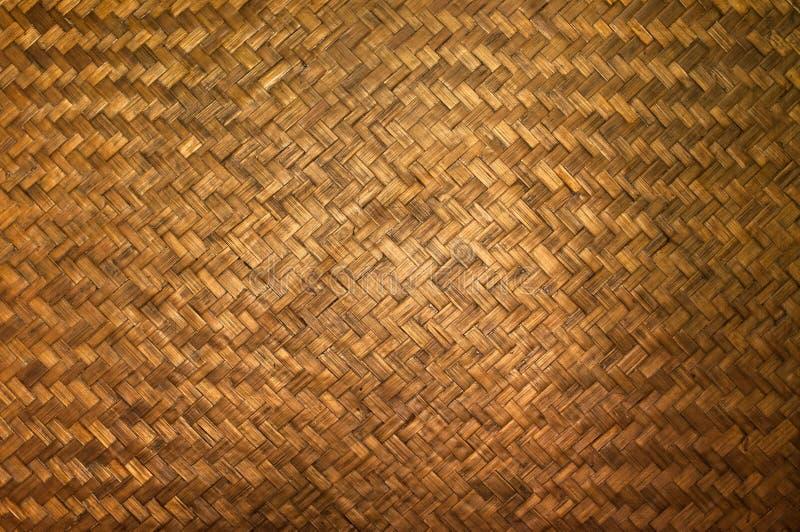 La struttura scura del dettaglio di bambù dell'artigianato, modello del bambù tailandese di stile handcraft il fondo di struttura fotografia stock